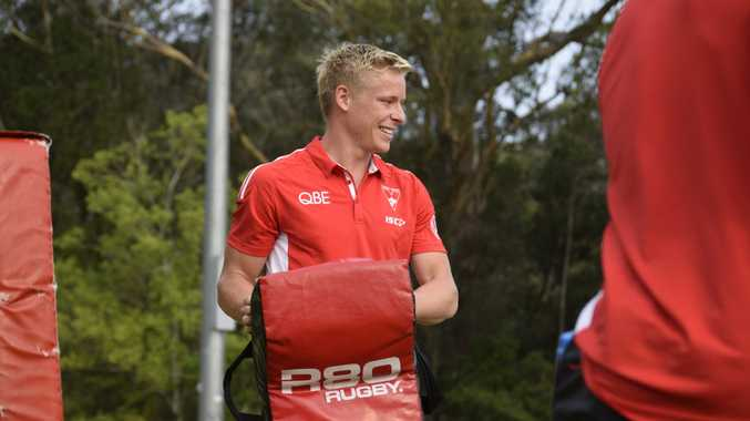 Swans find time to help RFS during pre-season camp in Coffs