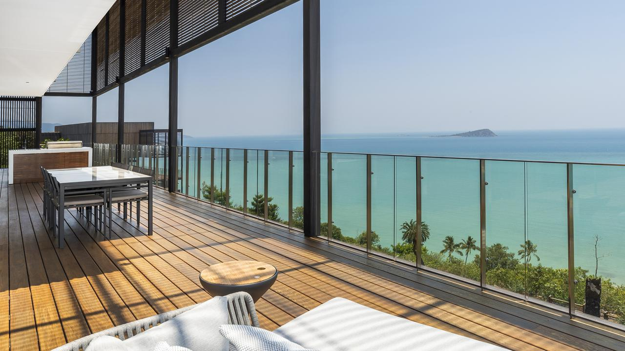 Perched on a hillside, the home has a sweeping view of the turquoise waters of the Whitsundays Passage.