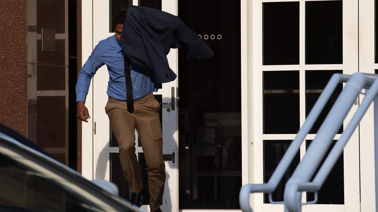 Renju Reghunath, 34, runs from the Supreme Court in Darwin after pleading not guilty to attempted rape. Picture: Keri Megelus