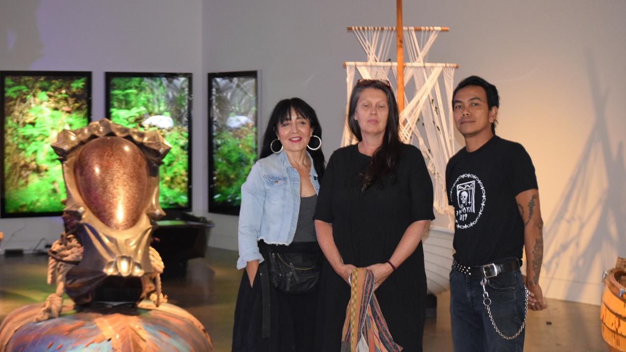 From left exhibition curator Pat Hoffie and local artists Penny Evans and Aris Prabawa among the works.