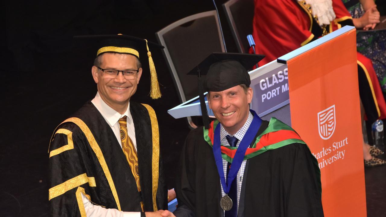 Charles Sturt University Vice-Chancellor Prof. Andrew Vann (left) with university medallist Robert Jeffries.