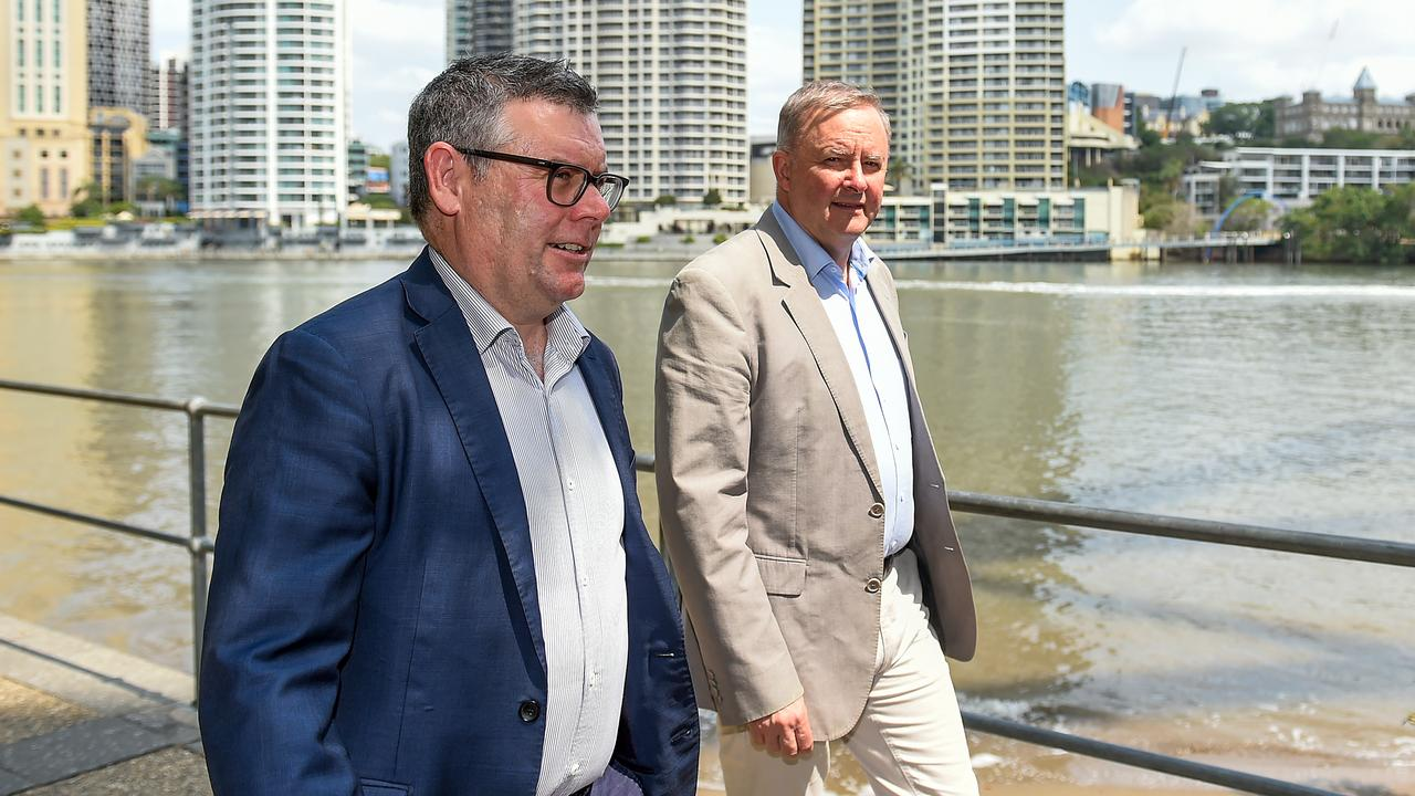 Labor Leader Anthony Albanese and Senator for Queensland Murray Watt stroll along the Brisbane River before embarking on a listening tour of regional Queensland. (AAP Image/Albert Perez)
