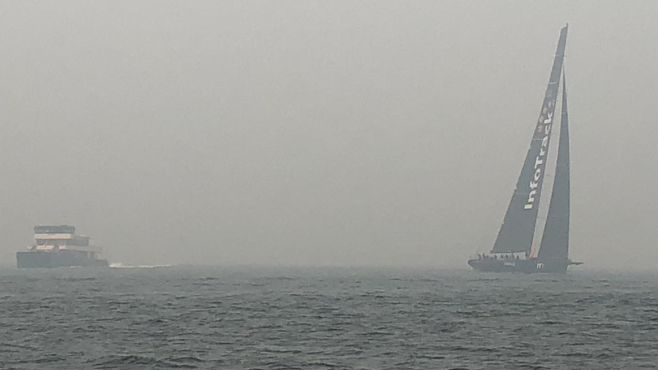 Smoke blanketed Sydney Harbour on Tuesday. Picture: Andrea Francolini.