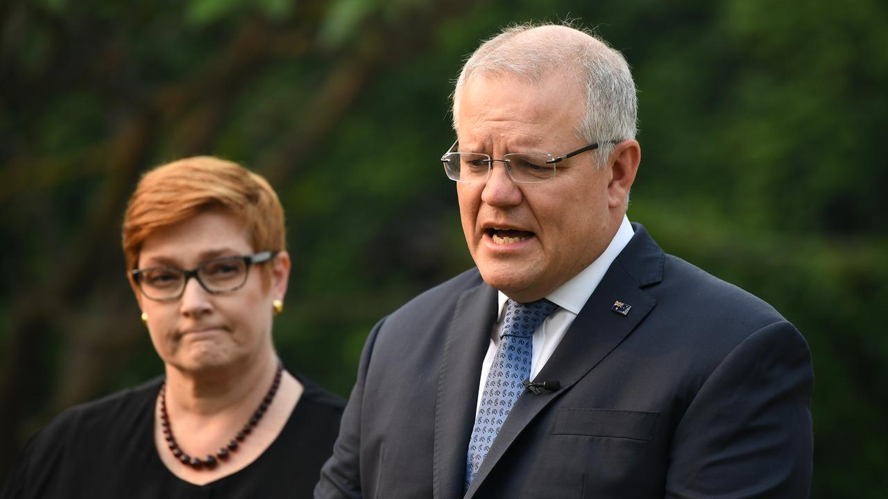 Australian Prime Minister Scott Morrison (right) and Foreign Minister Marise Payne address the media at Kirribilli House in Sydney, Wednesday, December 10, 2019. Up to three Australians have been killed after a volcano erupted in New Zealand. (AAP Image/Joel Carrett) NO ARCHIVING