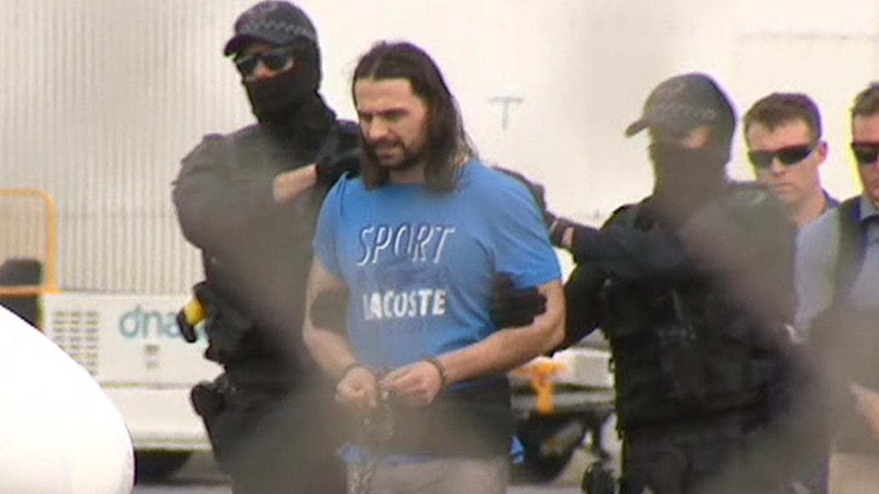 Agim Ajazi was extradited from Adelaide Airport on Sunday. Picture: Nine News