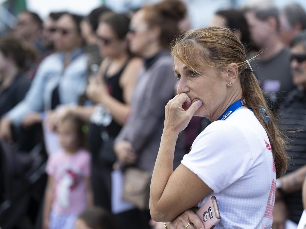 Shocked passengers gather for a solemn vigil at the Port of Tauranga. Picture: Brett Phibbs