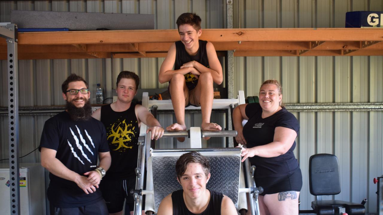 GYM FAMILY: L-R Nathan Russell, Travis Burton, Dylan Neumann, Blake Neumann, Penny Cooper at Ironsyde Gym