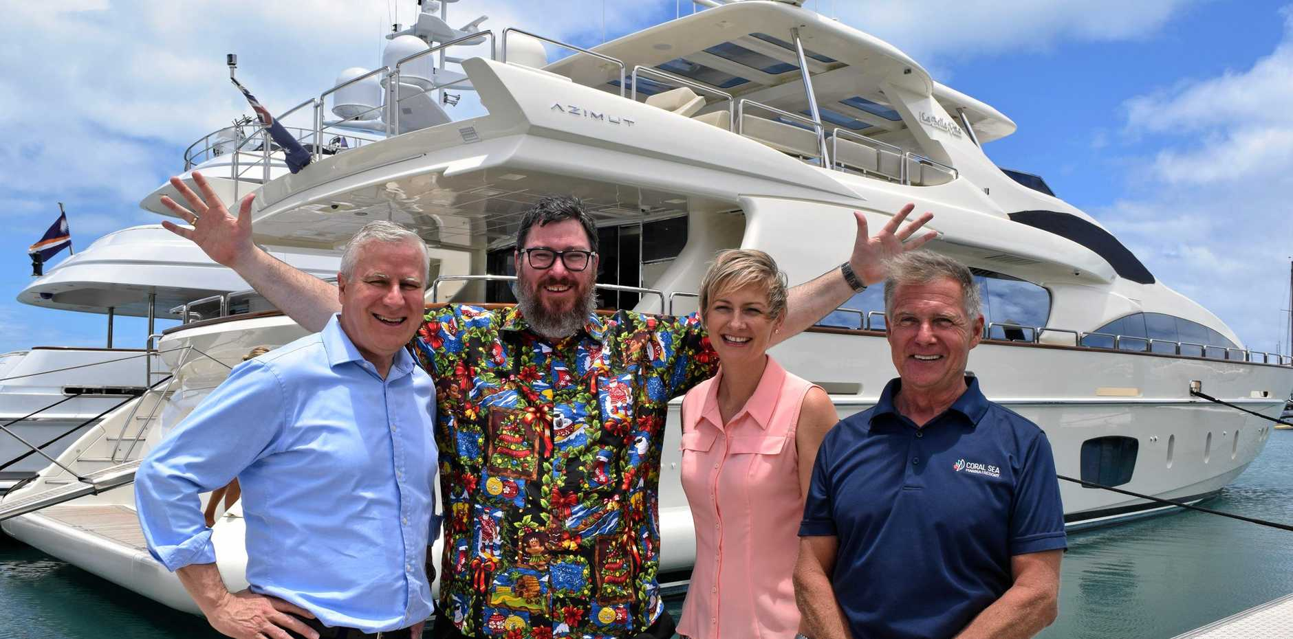 Deputy Prime Minister Michael McCormack, Federal Member for Dawson George Christensen, Whitsunday state LNP candidate Amanda Camm and Coral Sea Marina owner Paul Darrouzet at the marina celebrating legislation removing import duties for superyachts.