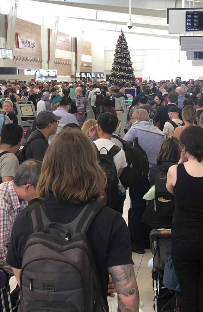 Adelaide Airport is evacuated to re-screen travellers after a screening machine malfunctioned. Picture: Jo De Silva