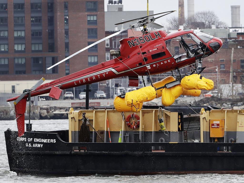 The helicopter wreckage being pulled out of the East River after the deadly crash. Picture: Mark Lennihan/AP