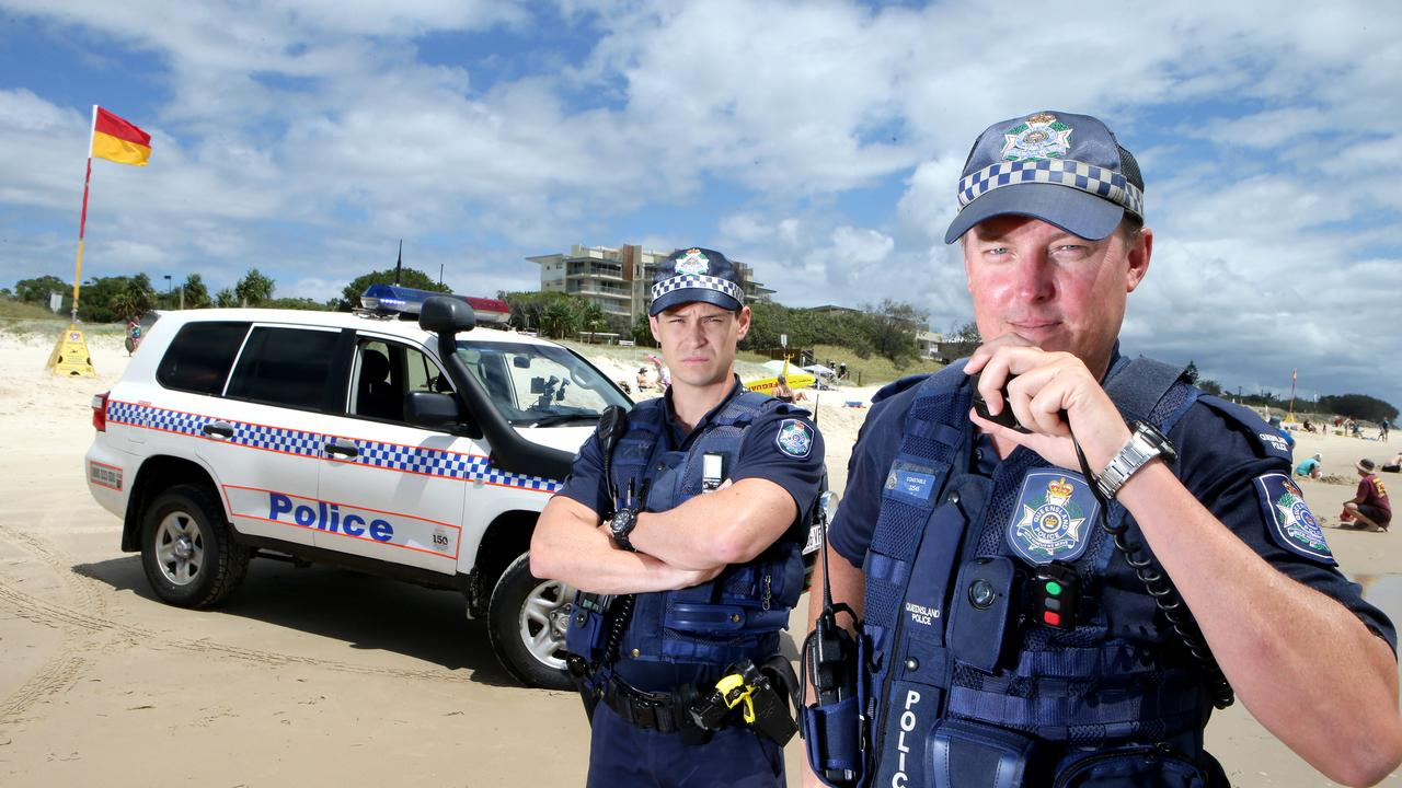 Pictured are police officers Con Ben Keatch (L) and Con Robbie Paul on Woorim beach, Bribie Island. Photo by Chris McCormack.