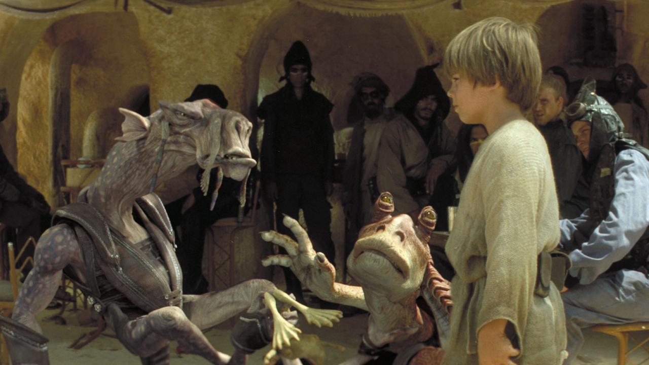 the best and worst of The Phantom Menace in one shot -— fans loved Anakin (right) in the pod race, but hated Jar Jar Binks (centre).