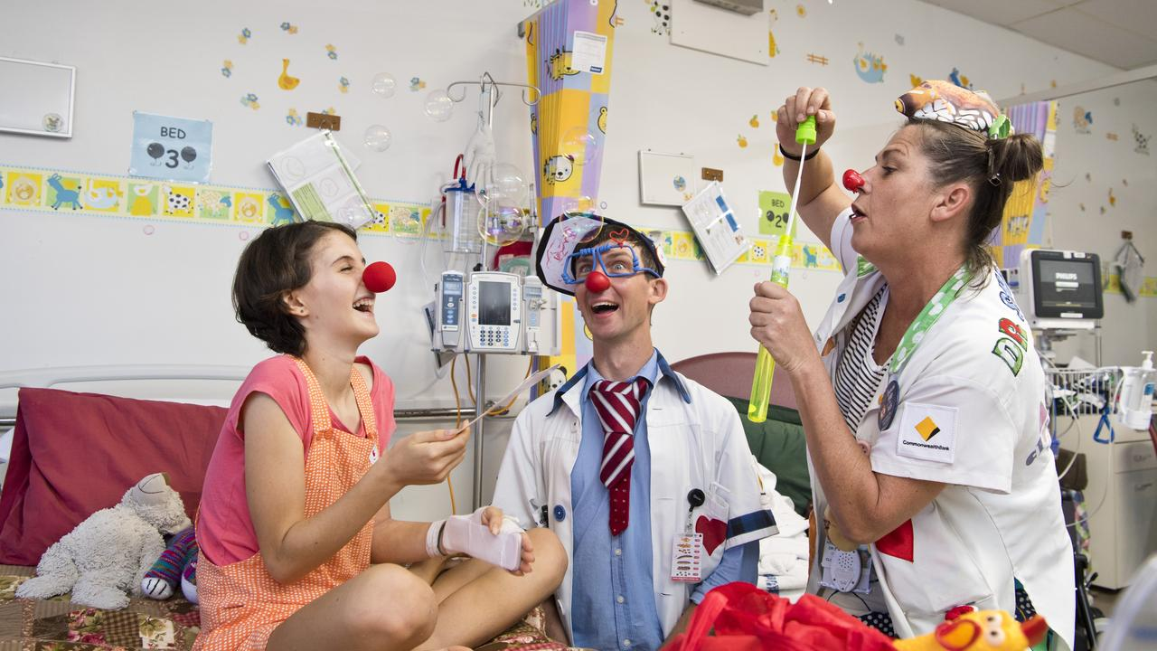 HEALTHY HUMOUR: Toowoomba Hospital patient Eva Palmer has fun with Dr O'Dear (Robbie O'Brien) and Dr Sniggles (Helen Quinlan) as the Humour Foundation's Clown Doctors visit. Picture: Kevin Farmer