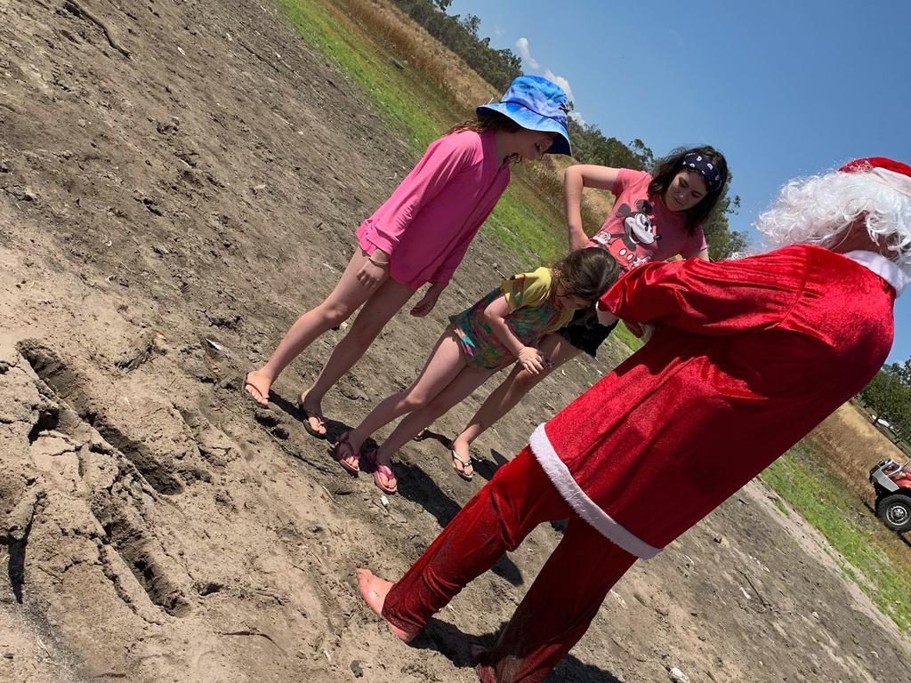 Santa was sinking at the waters edge at the Maraboon Power Boat & Ski Club 2019 Christmas party.
