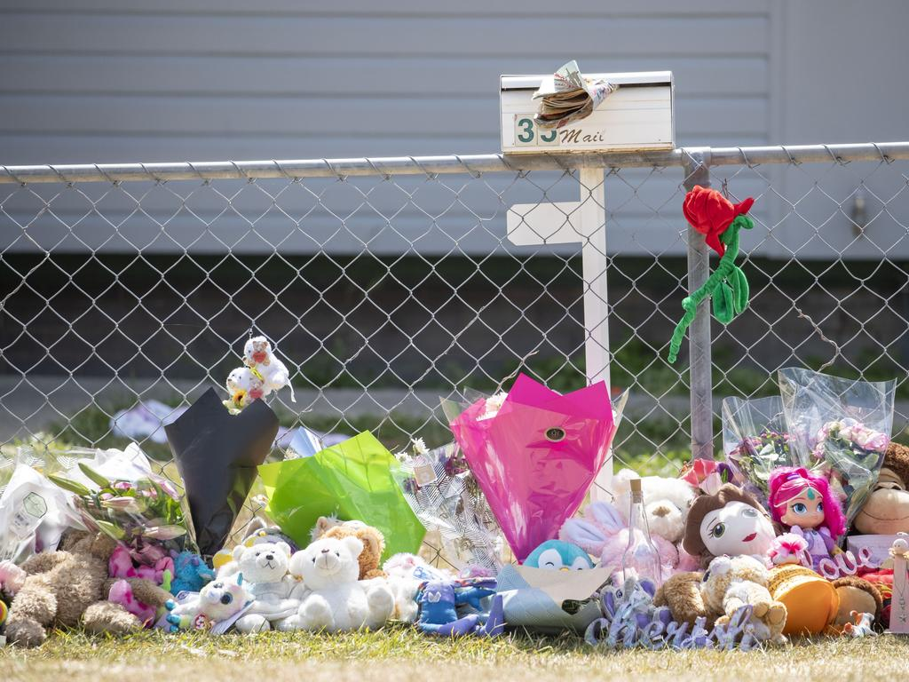 Tributes are seen at a house on Logan Reserve Road, Waterford West in Brisbane, Monday, November 25, 2019. The mother of two little girls who died in a hot car parked outside their home is the first person to be charged under Queensland's new definition of murder. (AAP Image/Glenn Hunt) NO ARCHIVING