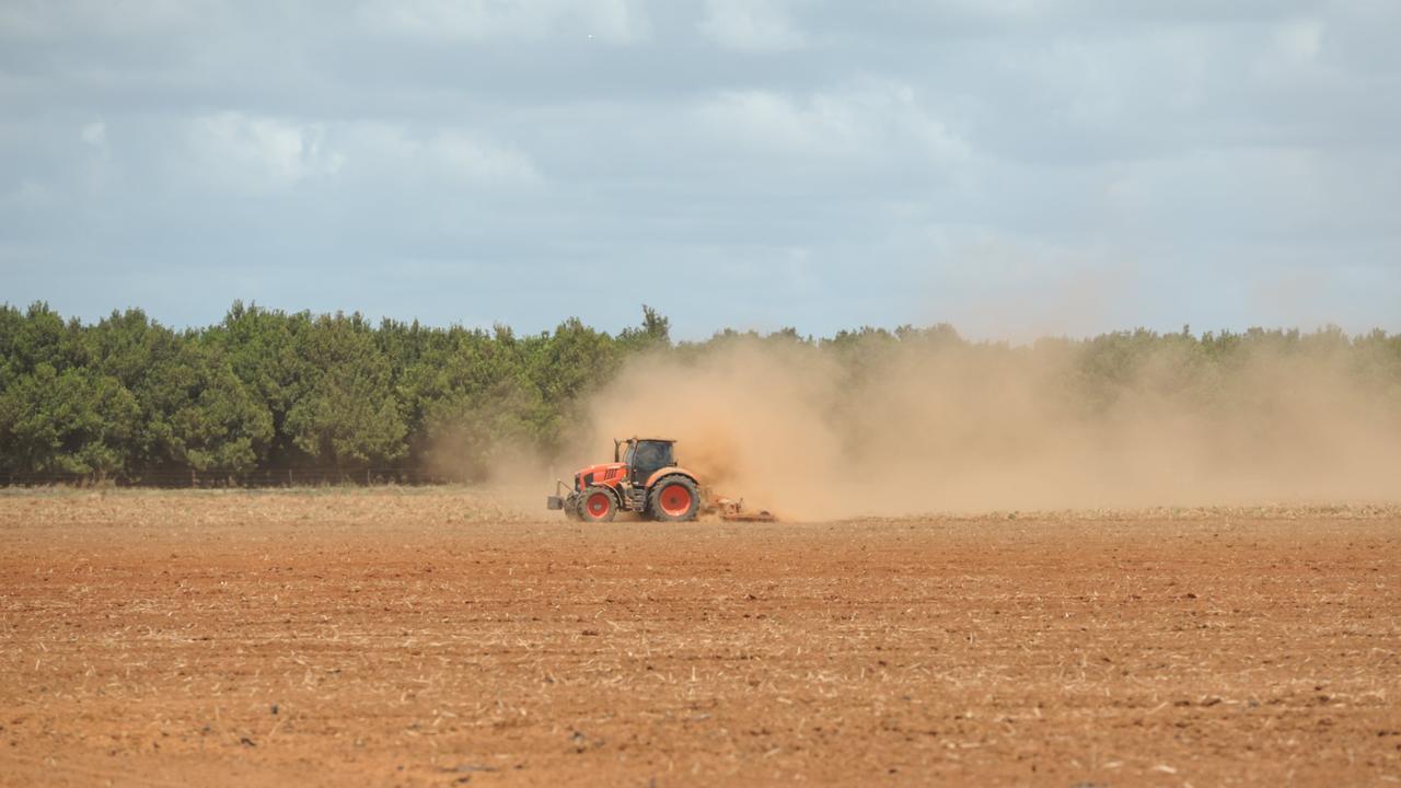 Farming dust. A tractor leaves a trail of dust on a Bundaberg farm.