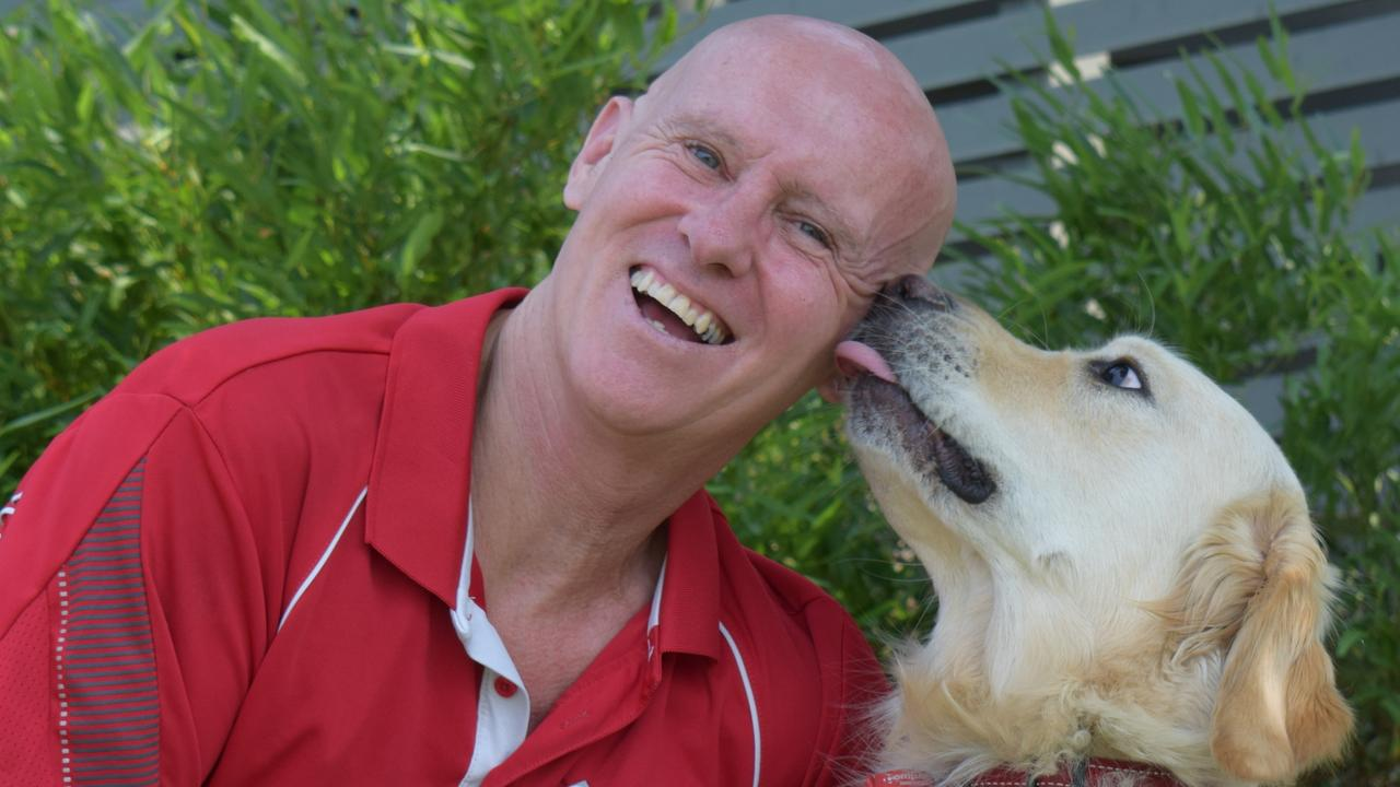 The Compass Institute assistance dog program operations manager Phil Brocklehurst with Caddy.