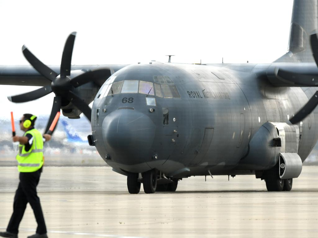 A C-130 Hercules arrives with survivors at Sydney Airport. Picture: AAP