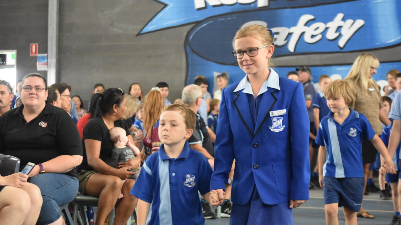 Dalby State School's graduating class walked into their graduation ceremony accompanied by prep students.