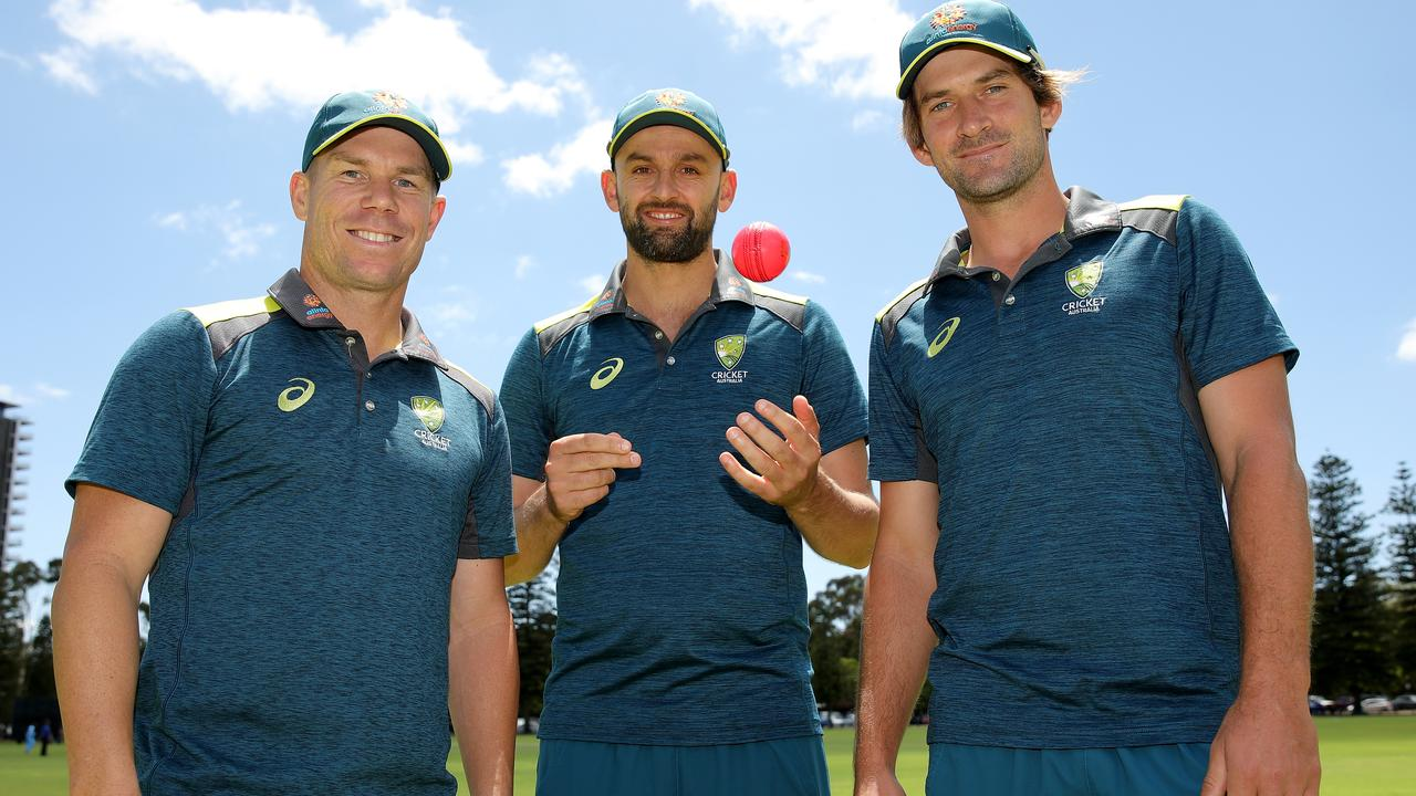 David Warner, Nathan Lyon and Joe Burns pose with the pink ball ahead of the Perth day-night Test.