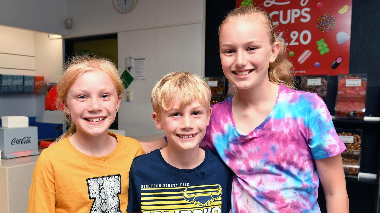 Addie McGuinness, 9, Leo McGuinness, 7, and Charlotte McGuinness, 11, at the final screening at the Mackay City BCC Cinemas. Picture: Tony Martin
