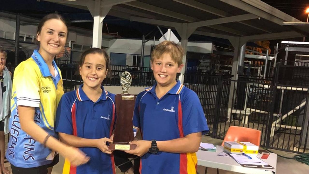 Taylah Fowler and Thomas Wass accepting the trophy on behalf of the Redeemer team for Highest Aggregate Points at the recent Moore Stephens Swimming Competition.