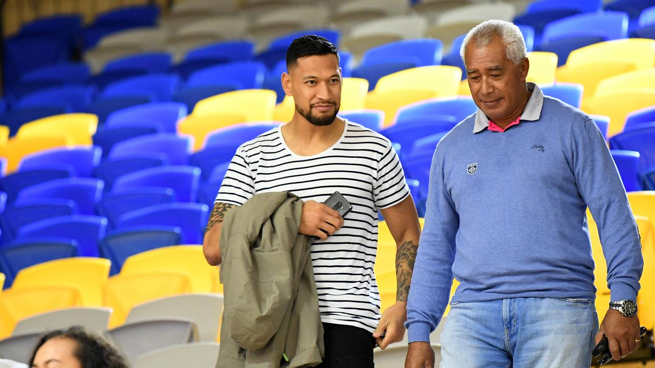 AT USC STADIUM Israel Folau (left) at a Super Netball match on the Sunshine Coast earlier this year. Picture: AAP Image/Dan Peled.