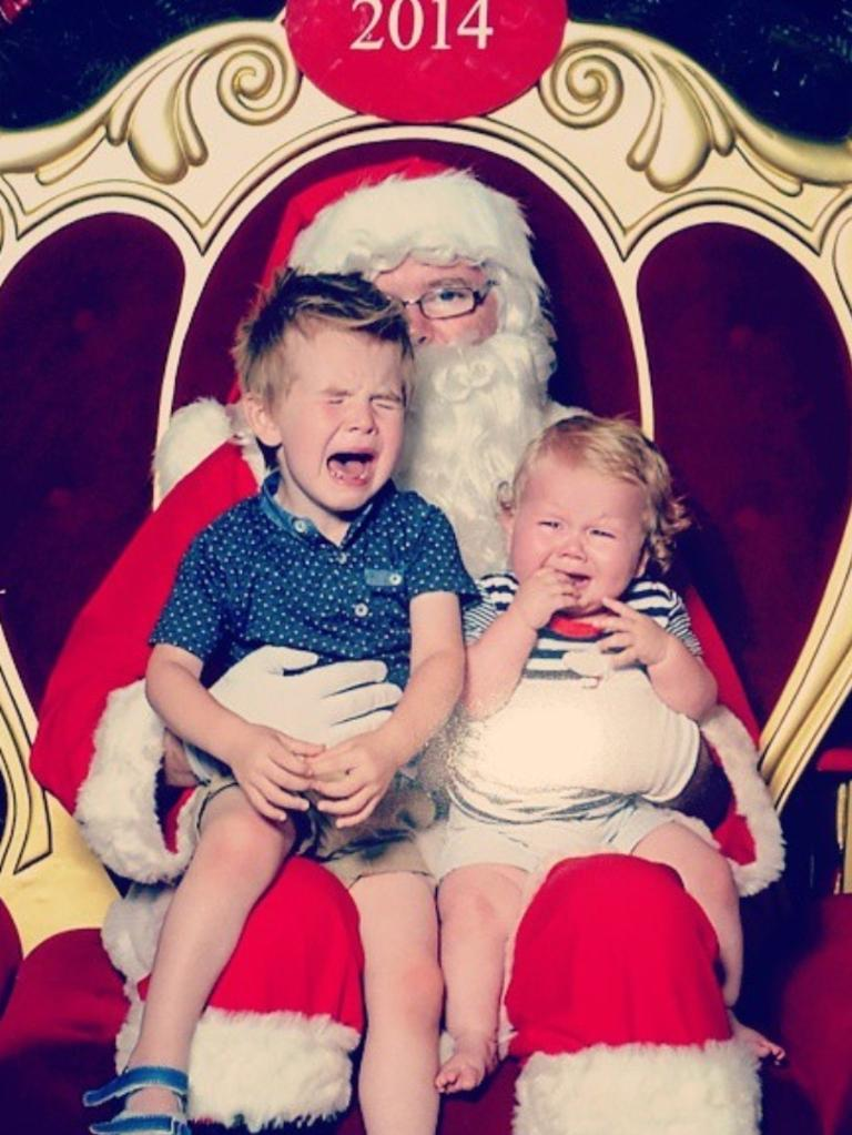 Ashlee Cox: My two boys in 2014. Brodie (3) and Logan (10 months) weren't too happy to meet Santa that year. Santa looks like he had had enough for the season too.