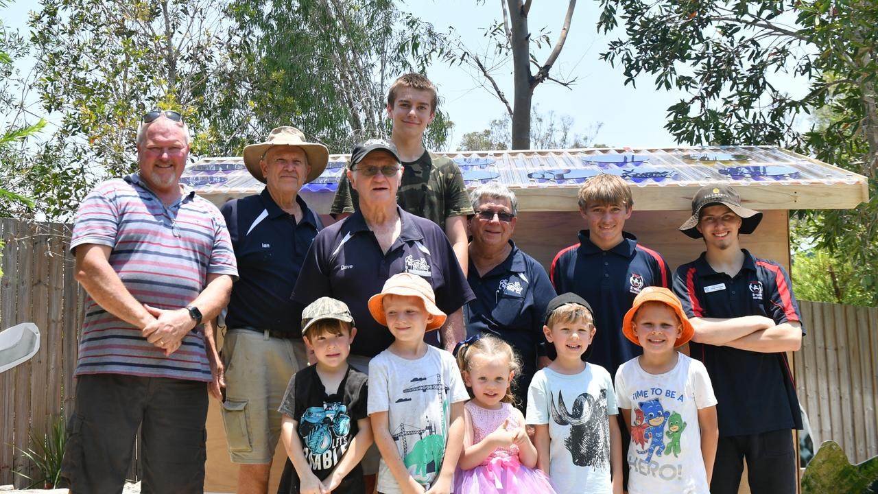 Paul Hayes, Ian Horseburgh, Dave Moore, Lochie Cathcard, Rob Steen, Jayden Munro, Jordan McIntosh (front) Sidney Radford, Beau Large, Tully Craze, Hudson Craze and George Young at the newly built cubby house at Rainbow Kids kindy.