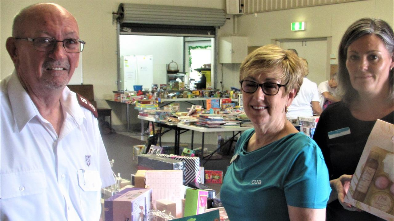 TIME OF GIVING: The Salvation Army's Major Brian Smith said toys and other gifts donated by Gympie's Credit Union Australia members will help ensure no-one is left out this Christmas. CUA's Maree Kelly and Sonya Ferguson delivered the gifts to Gympie's Salvation Army headquarters in Stumm Rd.