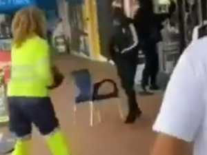 Lollipop lady throws chair at gunmen
