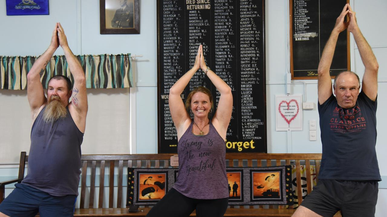 BREATHE DEEP: Russell Ritchings, yoga instructor Natalie Mann and Shane Stenhouse at a men's yoga class in Mundubbera. Photo: Alex Treacy