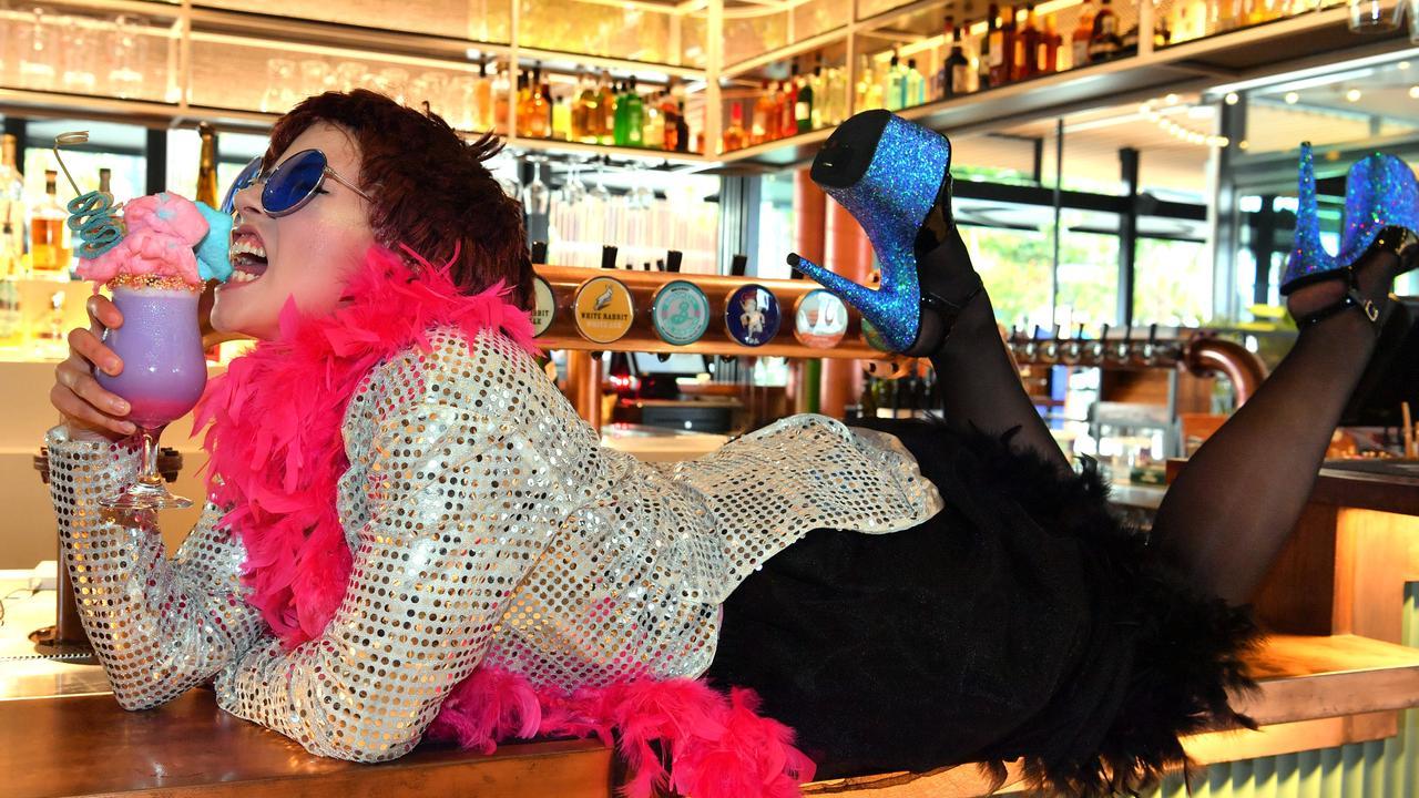 TINY DANCER: Tenayah Hamilton as Elton John with the limited-edition cocktail at Malt Shovel Taphouse in Birtinya. Photo: John McCutcheon