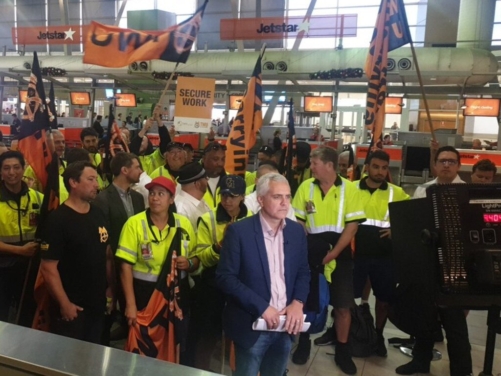 Jetstar staff with Transport Workers Union national secretary Michael Caine at Sydney Airport this morning. Picture: Twitter/@jackboutros1