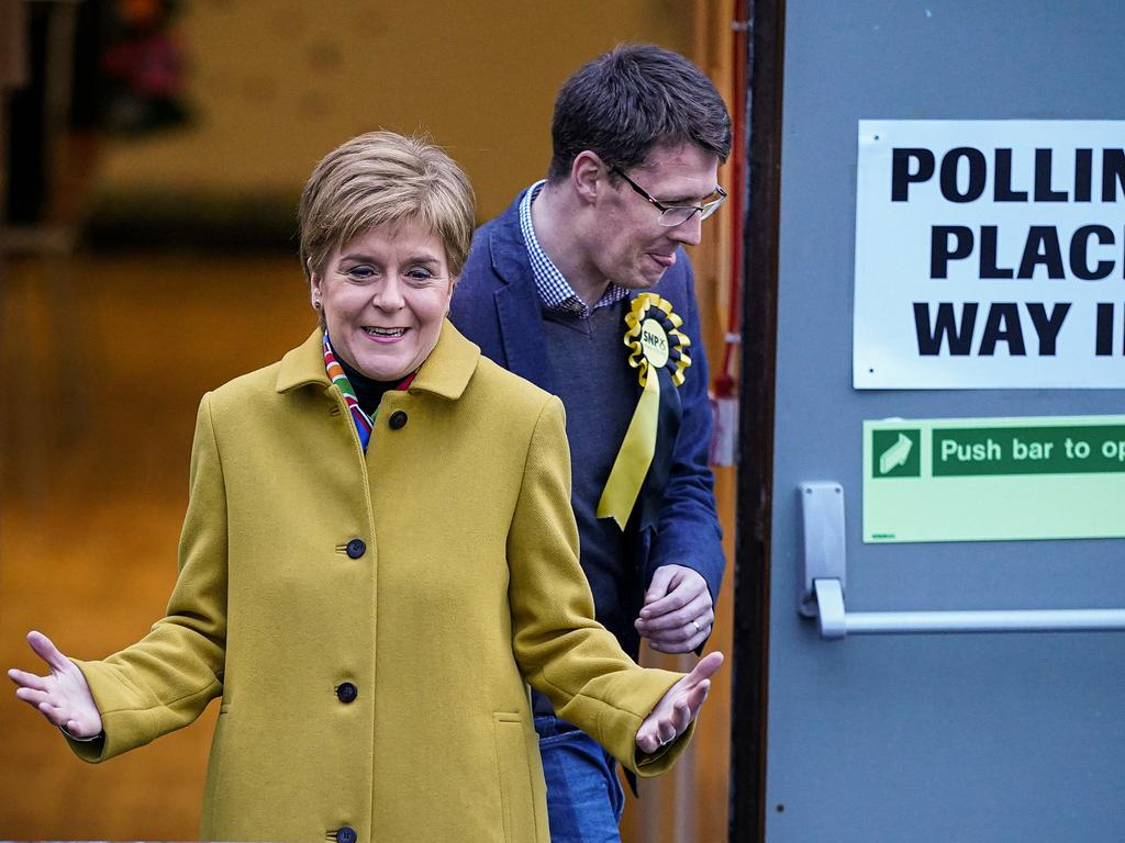 First Minister of Scotland and leader of the SNP Nicola Sturgeon and candidate David Linden vote at Broomhouse Community Hall in Ballieston. Picture: Getty