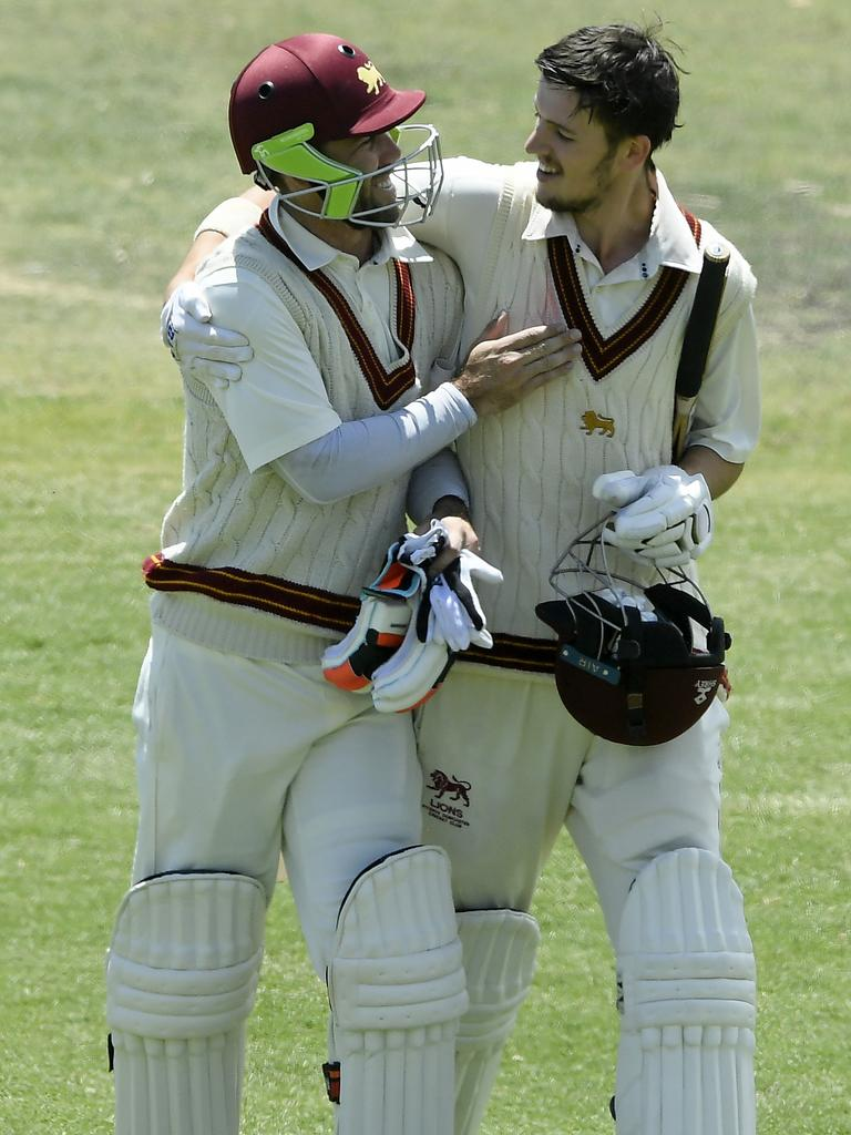 Glenn Maxwell leaves the field with Fitzroy Doncaster teammate Zach Elliott during his cricket return.