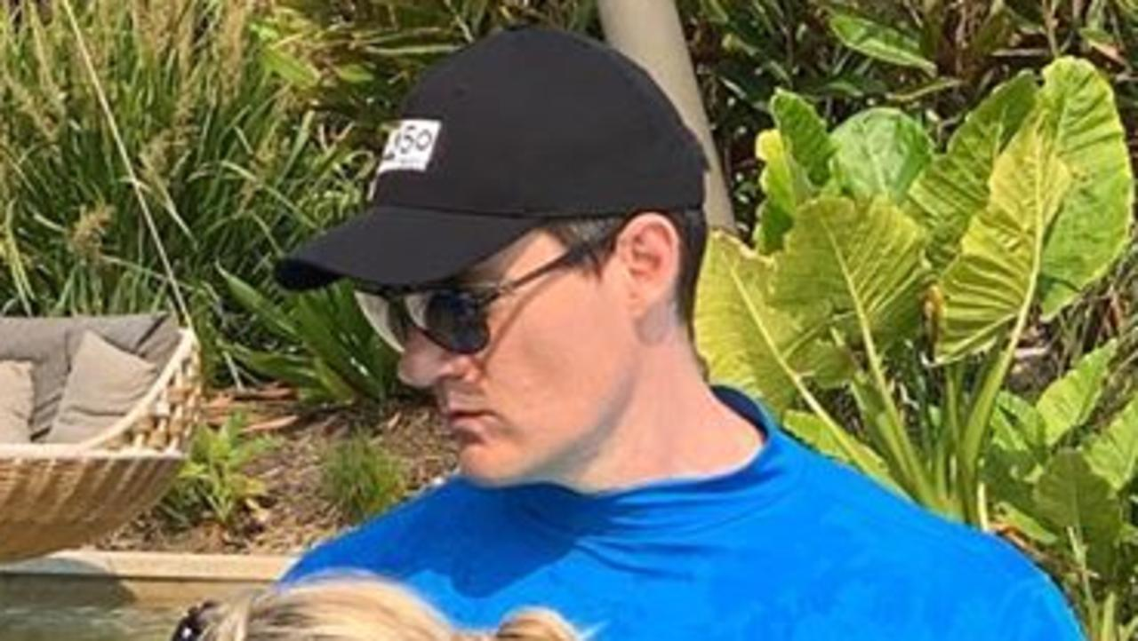 Tiff Hall shares a family photo while holidaying in Byron Bay – but fans couldn't help but notice Ed Kavalee's popping six-pack.
