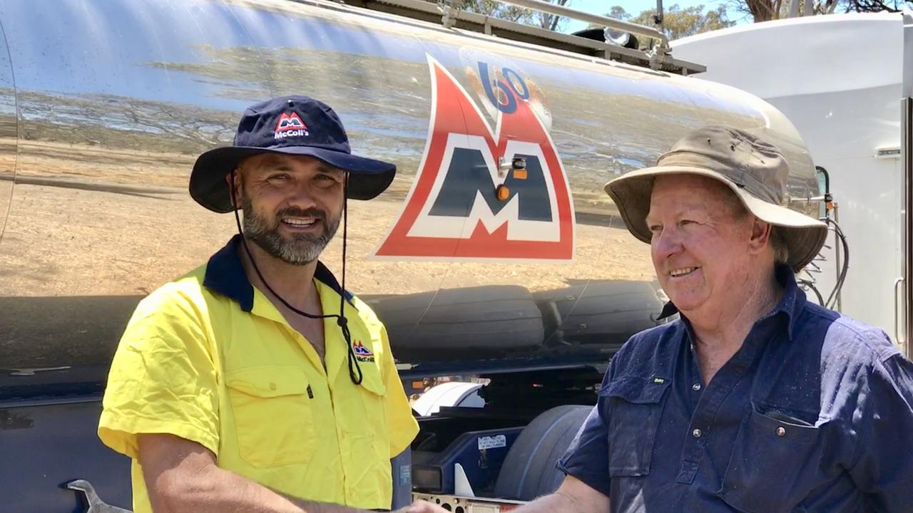 HELPING HAND: McColl's driver Jamie Luke and farmer Gerard Wren at the Wren's property at Dalveen.