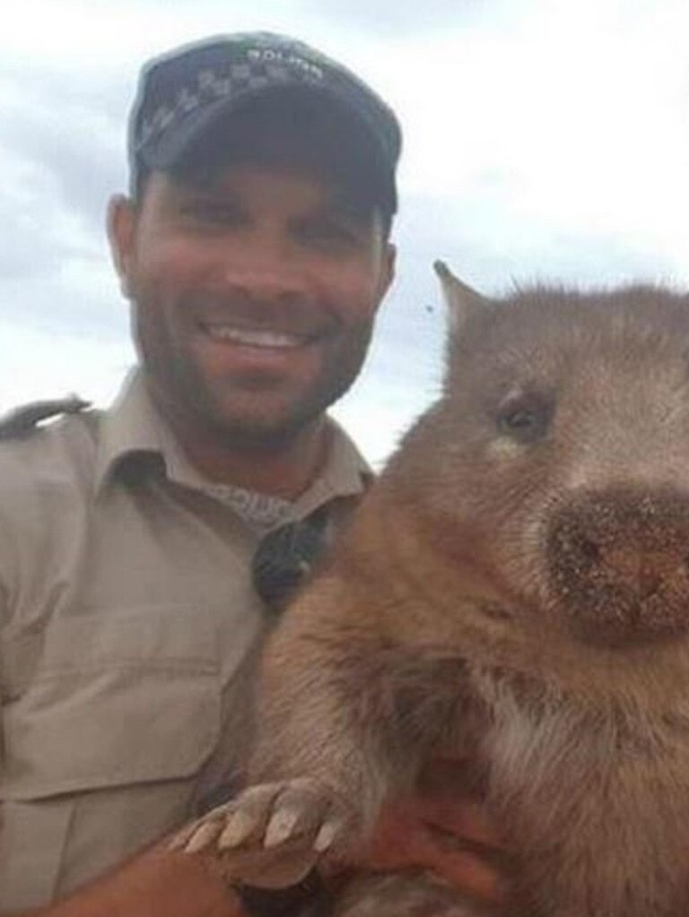 Waylon Johncock holding a wombat.