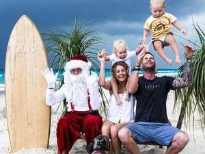 Tradie's surfy Santa photos a hit
