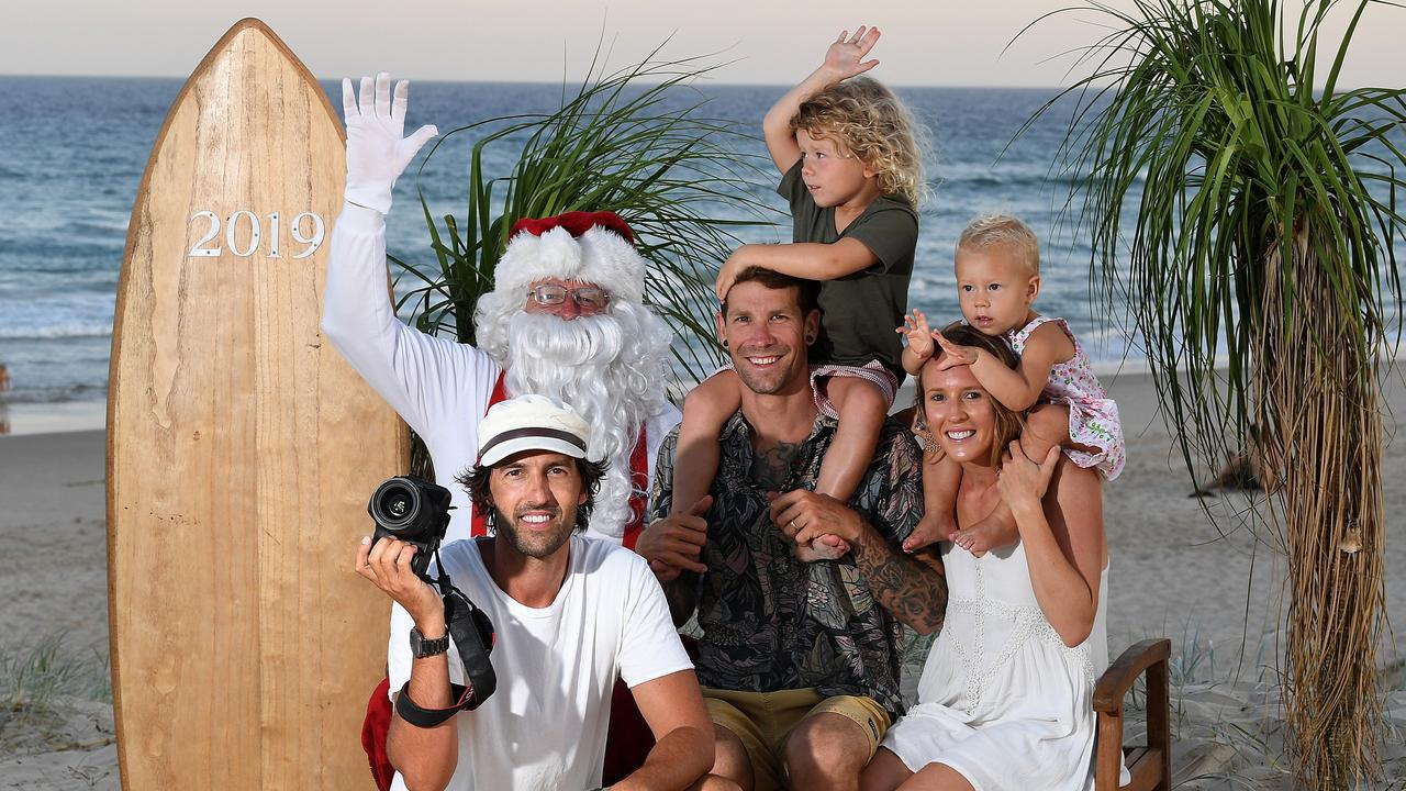 CHRISTMAS TO REMEMBER: Chris and Leigh Sharpe with son Ollie, 4, and daughter Elkie, 2, have made a tradition of Santa on the Beach photo shoots. Photo by Warren Lynam / Sunshine Coast Daily
