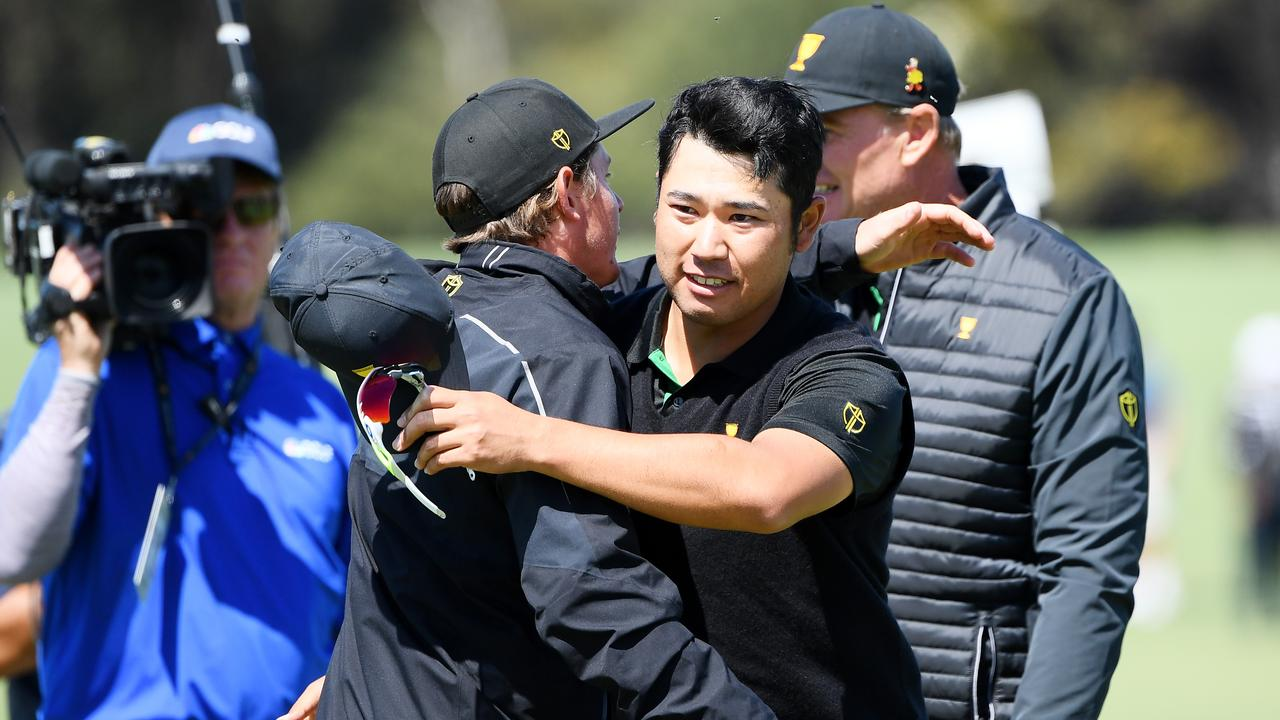 Cameron Smith congratulates Hideki Matsuyama after the Japanese star beat Patrick Reed.