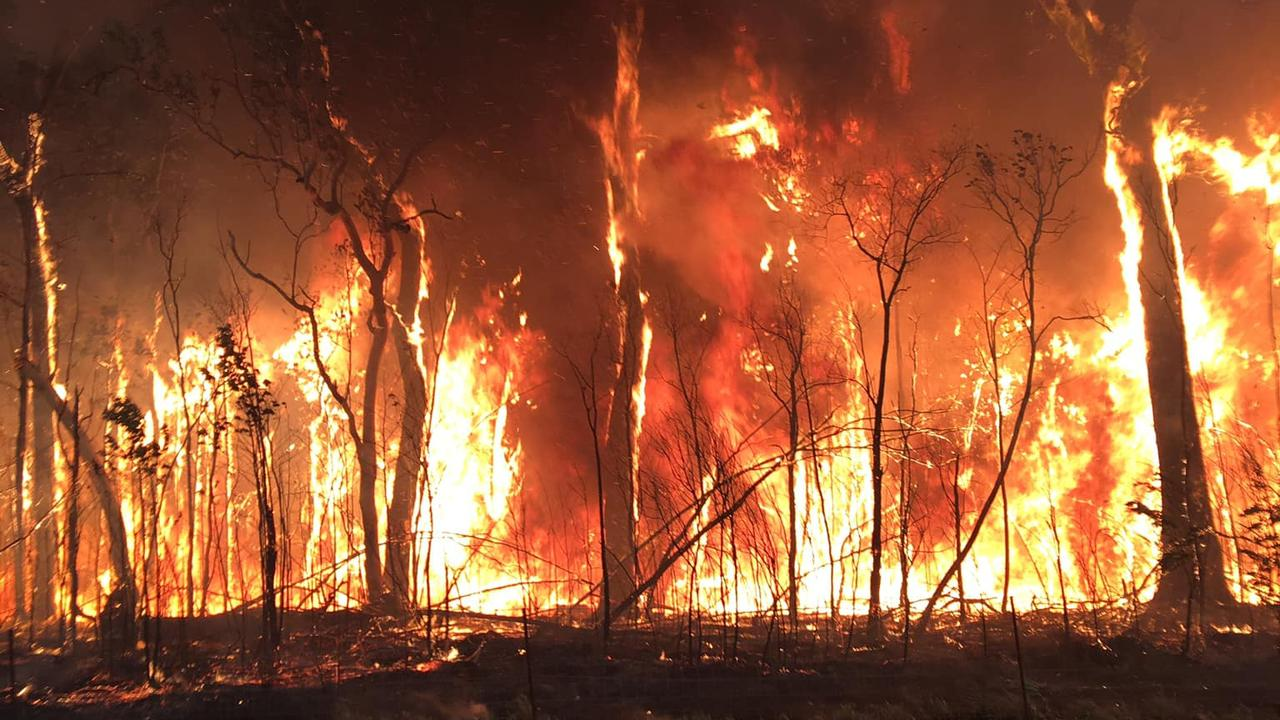 TOUGH JOB: There are calls to financially support Rural Fire Service firefighter volunteers who sometimes spend weeks fighting bushfires like this massive blaze which burnt along Old Byfield Rd, Cobraball in November. Picture: Anthony Carter