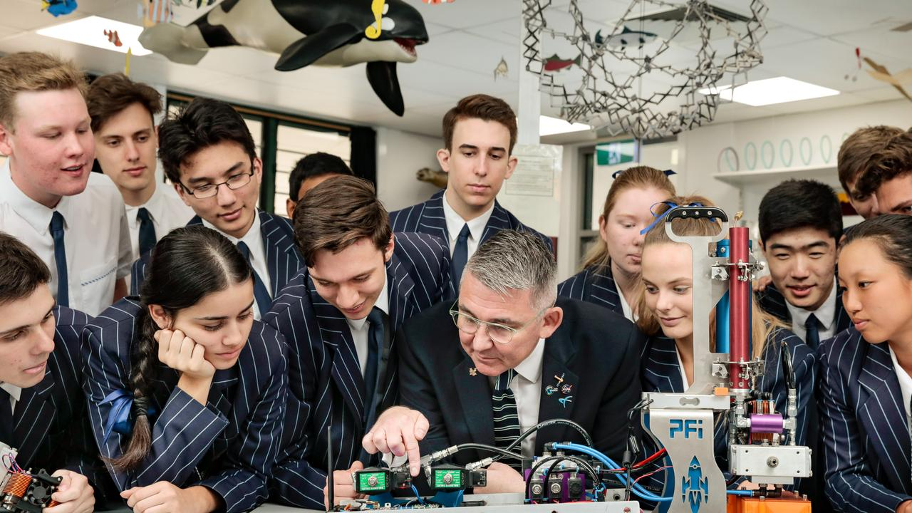 Students and teachers from Sheldon College take a look at the rocket-in a suitcase equipment.
