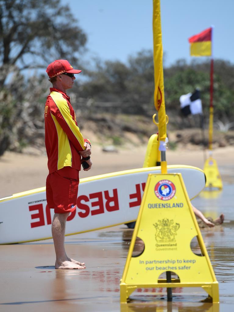 Lifeguard Ryan Miller keeps an eye on bathers at Nielson Park Beach.