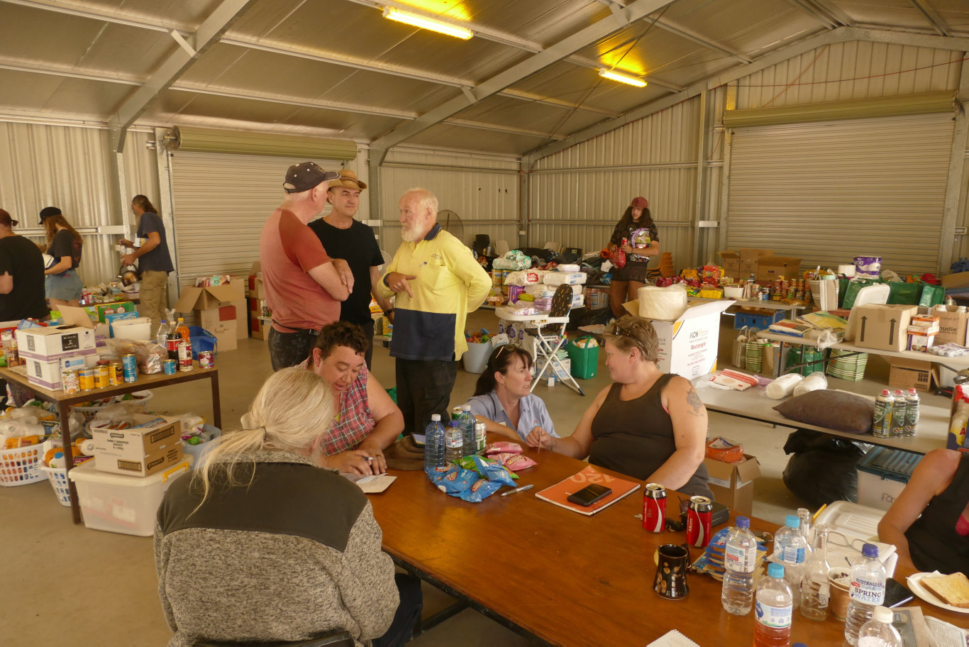 Nymboida residents co-ordinate distribution of donated goods in the canoe centre shed.