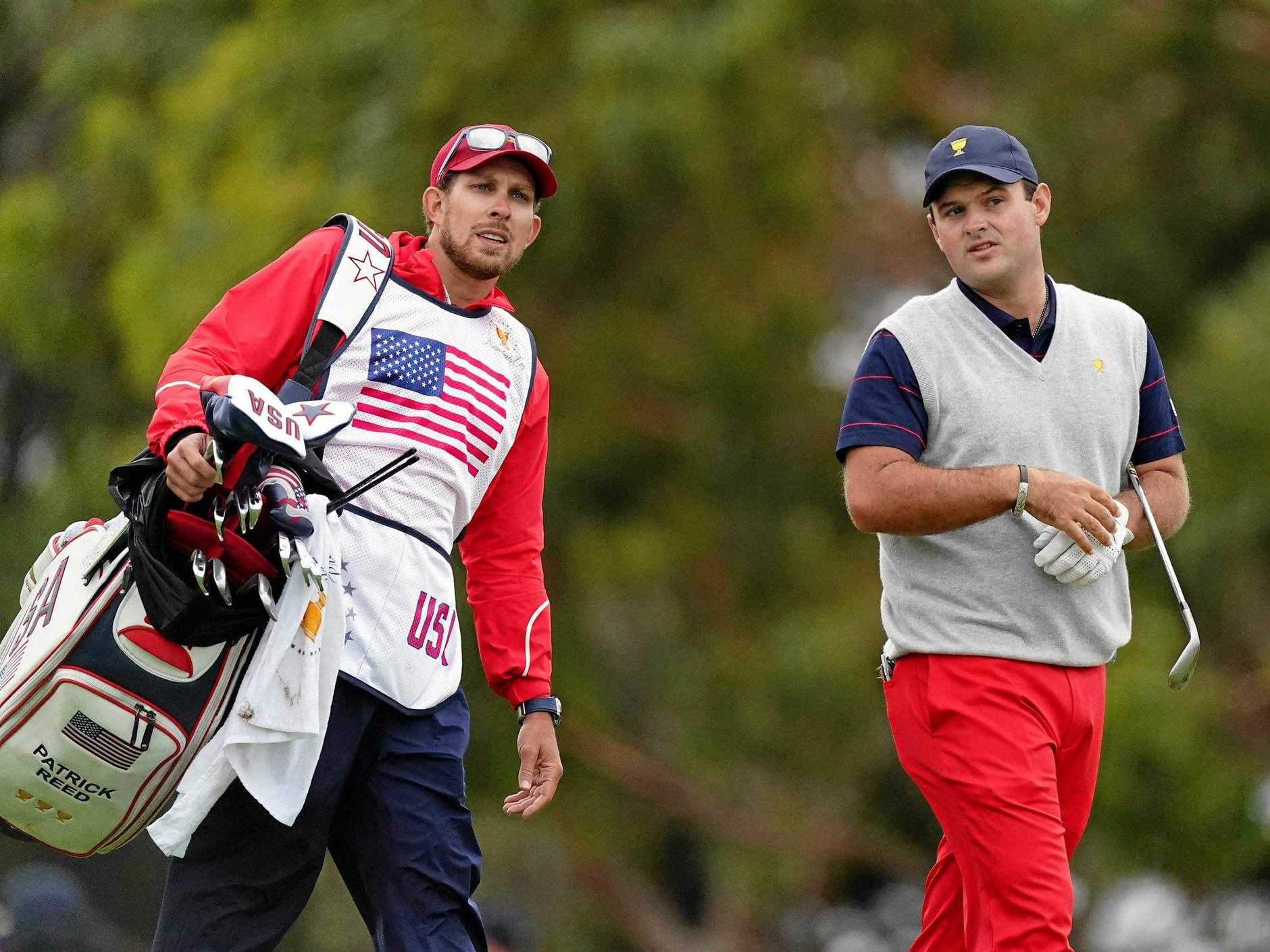 Caddie Kessler Karain and Patrick Reed of the US team look on during the Saturday four-ball matches at the Presidents Cup in Melbourne. Picture: Scott Barbour/AAP