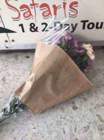 Flowers laid where a teenager was fatally stabbed outside a Gold Coast supermarket. Picture: Greg Stolz