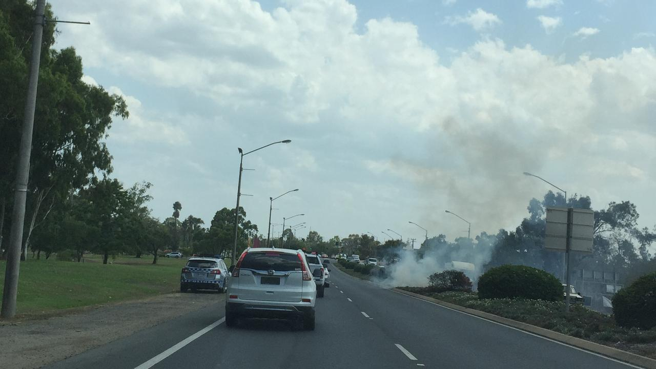 A fire on a North Rockhampton median strip flares up on Saturday afternoon.