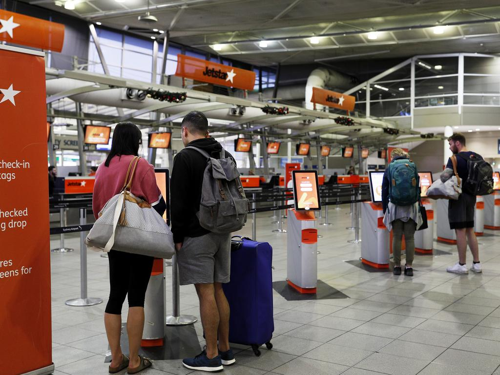 Passengers at Jetstar's self check-in area at Sydney Domestic Airport on Saturday as the pilot's strike affected flights around the country. Picture: Lisa Maree Williams.